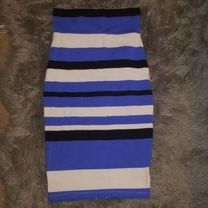 Bebe Midi Skirt with back slit. Very stretchy